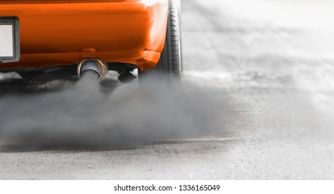 air pollution crisis in city from vehicle exhaust pipe on road