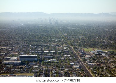 Air pollution from Interstate-10 and I-17 in morning haze above major Arizona city downtown of Phoenix as seen from the top of North Mountain Park hiking trails