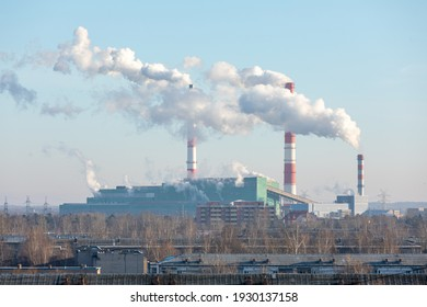 Air pollution from a natural gas and coal power plant. Emissions of harmful substances into the atmosphere. Traditional hydrocarbon energy. Electricity and heat production. Ecological concept.