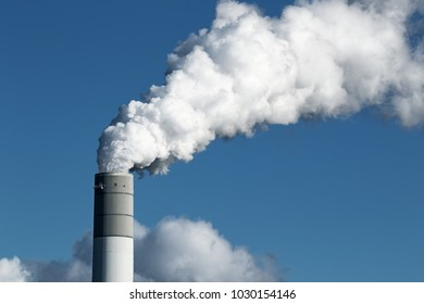 Air pollution from power plant chimney.