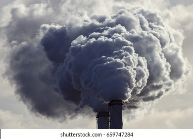 Air pollution from power plant chimneys.