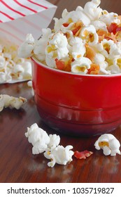 Air popped pop corn topped with a few bacon bits makes for a tasty snack while watching a home movie or awards show makes for a delicious indulgence