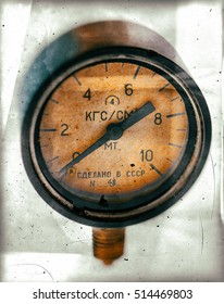 Air pressure gauge, old vintage soviet(Made in USSR), pressure gauge stylised as aged old b&w sepia toned photos. Industry background.