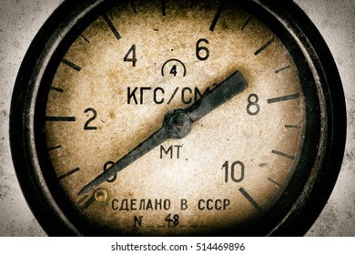 Air pressure gauge, old vintage soviet(Made in USSR), pressure gauge stylised as aged old b&w sepia toned photos. Industry background.