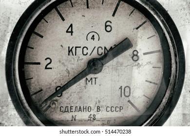 Air pressure gauge, old vintage soviet(Made in USSR), pressure gauge stylised as aged old b&w photos. Industry background.