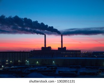 Air pullution in Russian city. Plant smoke against  dusk skyline.