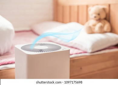 air purifier in bed room. air cleaner removing fine dust in house.