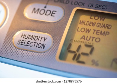 Air Purifier and dehumidifier. Concept for dehumidifying room. Humidity selection button. Humidity percentage display. Close-up device.