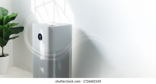 air purifier a living room,  air cleaner removing fine dust in house. protect PM 2.5 dust and air pollution concept - Shutterstock ID 1726602145