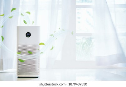 air purifier a living room,  air cleaner removing fine dust in house. protect PM 2.5 dust and air pollution concept - Shutterstock ID 1879489330