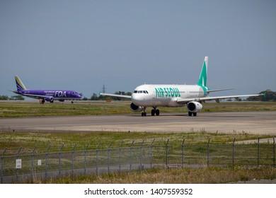 Air Seoul A321-200 before taking off from Mt. Fuji Shizuoka Airport, and Fuji Dream Airlines JA06FJ just landing at Mt. Fuji Shizuoka Airport, Shizuoka, Japan, May 11th 2019