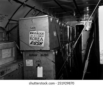 Air shipments of whole blood from American Red Cross for Korean War casualties. It will be stored in Yokohoma, for shipment to Korea as needed. Korean War, 1950-53.