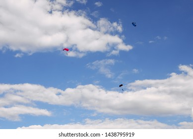 air show on the blue sky - parachute jumping