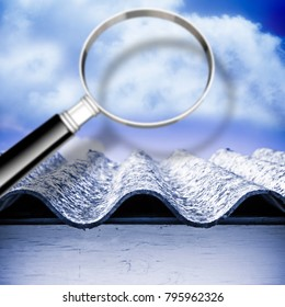 Air testing and monitoring activity around a dangerous asbestos roof - concept image with magnifying glass
