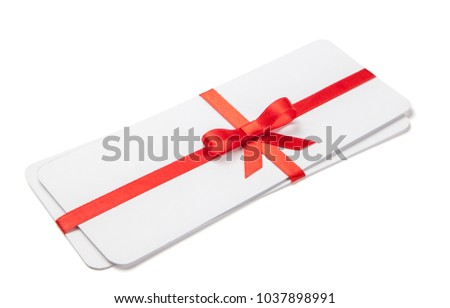 Air tickets as a gift with a red ribbon and bow. Isolated on white background; mock-up