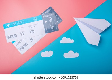 Air tickets and paper plane on pastel background, topview. The concept of air travel and holidays