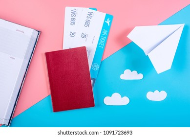 Air tickets with passport and paper plane on pastel background, topview. Bright background. The concept of air travel and holidays