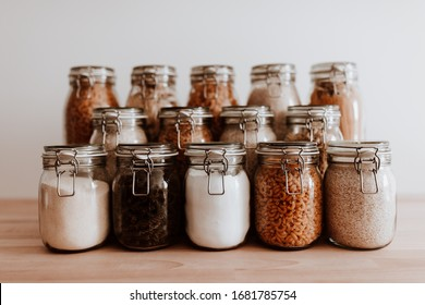 Air tight glass jars filled with rice and pasta and basic ingredients