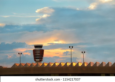 Air Traffic Control or ATC tower at a moderm airport, rightly considered as the nerve centre of air traffic, against backdrop of a breathtaking sunset sky. Copy space.