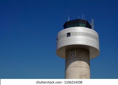 Air traffic control tower in front of a blue sky