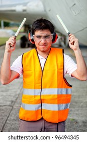 Air traffic controller holding light signal at the airport