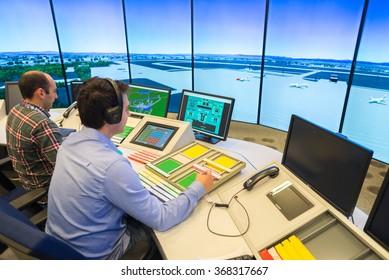 "Air Traffic Controllers in air traffic simulator center with monitors and radar in the""Bulgarian Air Traffic Services Authority"" (BULATSA), Sofia, Bulgaria, November 12, 2015."