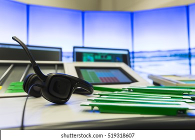 Air traffic controllers at work in the flight control tower at Sofia's airport. Headset. Air traffic control directs aircraft on the ground and through controlled airspace.