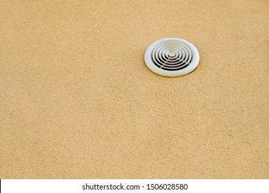 Air vent on beige wall of the house. Copy space. Minimalism.