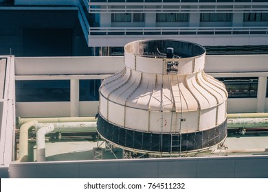Air Ventilation Chimney with Water Cooling or Evaporating System on Big Building or Factory Rooftop Spinning Cool Wind into the Building Aerial Top View as Architectural or Industrial Background