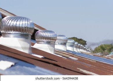 Air ventilator on the roof,Ventilators on the roof top spinning and take cool wind into the building, selective focus