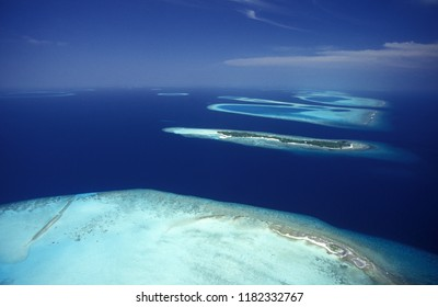a air view of the seascape at the island and atoll of the Maldives Islands in the indian ocean.   Indian Ocean, Maldives, February, 2003