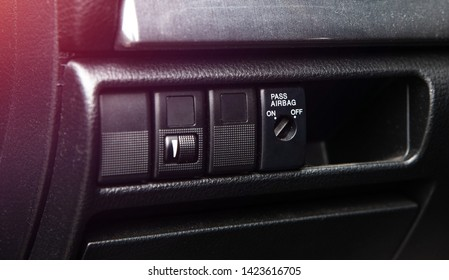 Airbag switch in the car. Button that activates or deactivates the airbag mechanism. Concept of car safety and health. Prevention of the consequences of an accident.