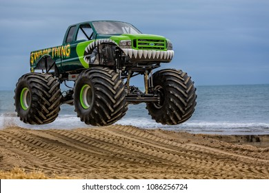 Airborne monster truck at the beach taken at Bournemouth, Dorset, UK on 31 May 2015