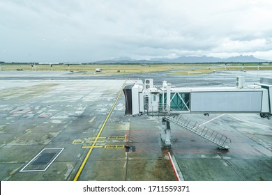 Airbridge, jet bridge, passenger boarding bridge with no aircraft, airplane at an empty or closed airport concept no air traffic during lockdown in Cape Town, South Africa dealing with Corona virus