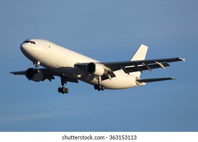 Airbus A300 civil cargo airplane landing in airport.