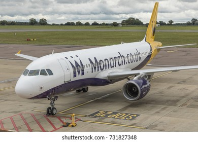 Airbus A320 aircraft, G-OZBX, of Monarch Airlines parked up on October 7th 2017 at London Luton Airport, Bedfordshire, UK