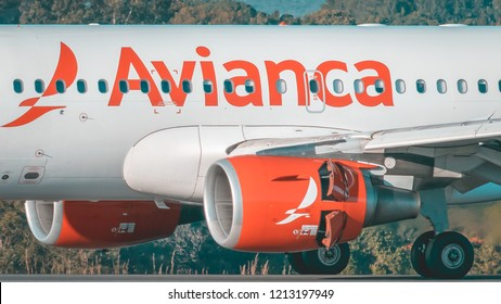 Airbus A320 Avianca Brasil at the Brasilia International Airport. Photo taken on May 27, 2017. In the image the Airbus aircraft is taxiing on the runway.