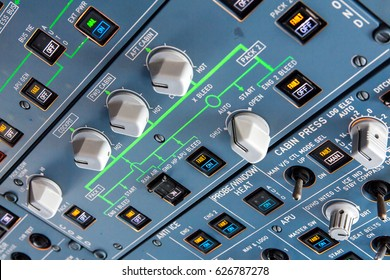 Airbus A320 overhead panel with switches and knobs for controlling various aircraft systems and components.