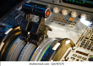Airbus A320 thrust levers on the centre pedestal instrument panel. Switches and dials visible in the background.