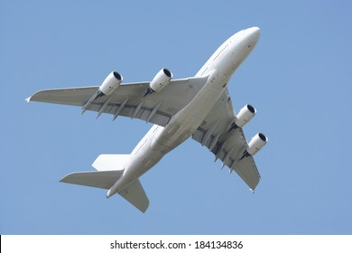 Airbus A380 fly-by. Clear blue sky.
