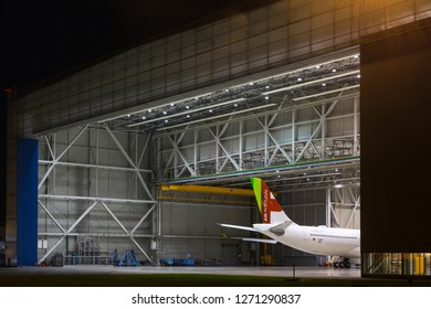 Airbus factory, Blagnac Airport, Toulouse / France - 12.18.2018. New passenger aircraft Airbus A330neo of TAP Portugal in the hangar during maintenance. Night time.