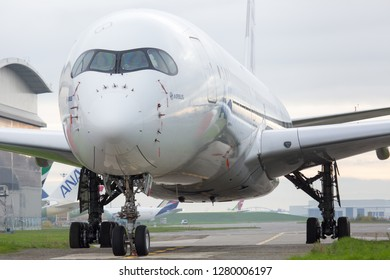 Airbus Plant, Blagnac Airport, Toulouse, France -  12.15.2018. Prototype of modern passenger aircraft Airbus A350-1000 XWB. Front view.