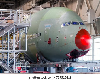 Airbus Plant, Toulouse, France - 10.06.2017. Factory inside. The final assembly shop. Two-deck passenger airplane Airbus A380 in the process of creating. Close-up.