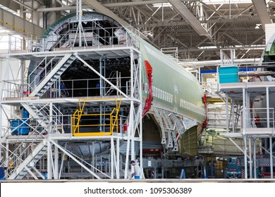 Airbus Plant, Toulouse, France - 30.03.2018. Factory inside. The final assembly shop. Double-deck passenger airplane Airbus A380 in the process of creating. Close-up.