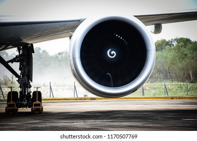 Aircraft (airplane) engine creating mini tornado (vortex) into inlet duct while running engine for ground test after maintenance.