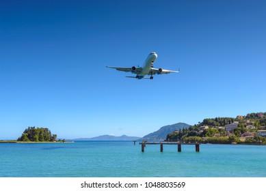 Aircraft approaching Corfu International Airport. Corfu island, Greece.
