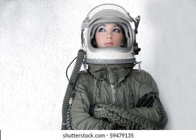 aircraft  astronaut spaceship helmet woman fashion portrait over silver