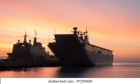An aircraft carrier moored at port in a spanish naval base near to Cadiz. A huge military aircraft carrier at port.