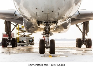 Aircraft chassis for maintenance.The chassis of a civilian aircraft, sunset