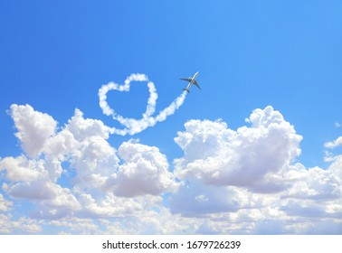 Aircraft draw a heart in the sky. Flight route of aircraft in shape of a heart. Love concept for traveling the world. Copy space for text